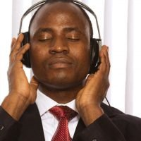Relaxed Man Listening to Guided Imagery