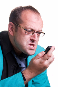 Stressed Man on Cellphone Image
